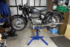 Classic BMW motorcycle on Big Blue lift